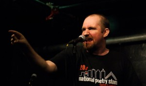 Adam Stone performs at the Cantab Lounge during the 2011 National Poetry Slam. Photo by Mark Skrzypczak.