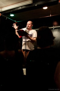 Adam Stone reads from one of his approximately 1,000,000 notebooks. Photo by Marshall Goff.