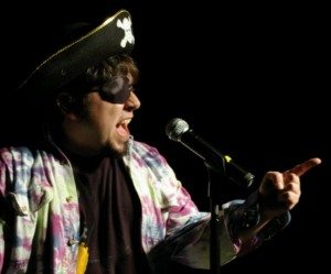 Kevin Spak on the Emerson College mic in costume (as if we had to tell you). Photo by Artie Moffa.