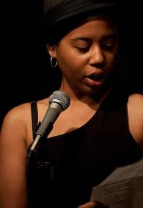 Maya Phillips performs on the Cantab open mic. Photo by Marshall Goff.