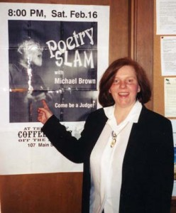 Valerie Lawson shows off a poster for the first poetry slam at the Old Ship Church Coffeehouse in Hingham, Mass. Photo by Michael Brown.