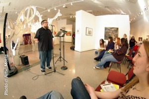 The 2010 audience listens up to feature Mike McGee at the Attleboro Arts Museum Slam. Photo by Artie Moffa.