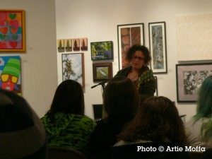 Poet-musician Sou MacMillan performs after workshopping at the 2008 Attleboro Arts Museum Slam. Photo by Artie Moffa.