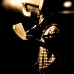 McKendy Fils-Aimé, our 2012 IWPS representative, performs on the Cantab open mic. Photo by Cassandra Ashley.