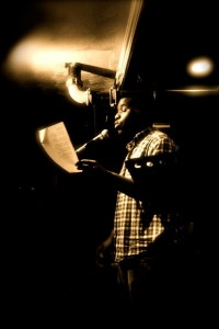 Mckendy Fils-Aimé performs on the open mic at the Cantab Lounge. Photo by Cassandra Ashley.