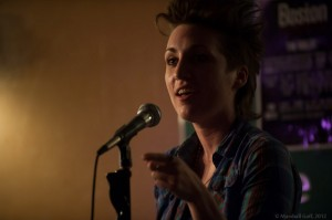 Carrie Rudzinski brings a new poem to sacrifice for the slam. Photo by Marshall Goff.
