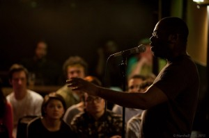 Omoizele Okoawo holds the audience spellbound. Photo by Marshall Goff.