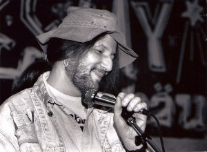 Richard Cambridge performs at Naked City (now the Squawk Coffeehouse) in 1990. Photo by Jeff Achenbach.