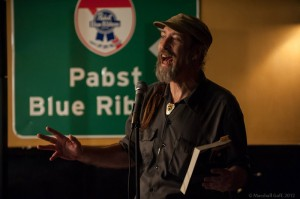 Local poetry celebrity Tim Mason stops by to party at the Cantab anthology party. Photo by Marshall Goff.