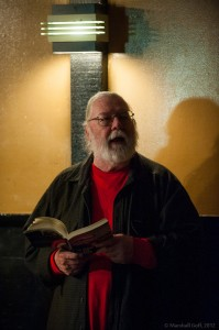 Michael Brown, founding SlamMaster, reads his own work from the Cantab anthology. Photo by Marshall Goff.