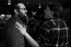 Zeke Russell, one-time Mill City SlamMaster, is congratulated by Bobby Crawford at the conclusion of the 2015 Team Selection Semi-Finals. Photo by Marshall Goff.