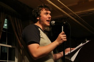 Ed Wilkinson performing at Manchester's Slam Free or Die. Photo by Christopher Clauss.