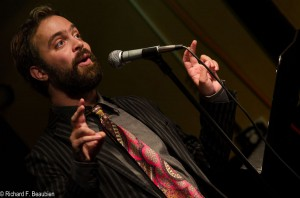 Andrew Campana takes the stage as the featured poet on October 15, 2014. Photo by Rich Beaubien.