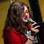 Jess Riz, pizza pi press curator, reads during the open mic. Photo by Rich Beaubien.