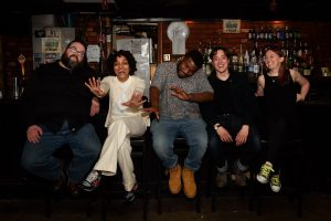 The 2016 Boston Poetry Slam Team is: Zeke Russell, Neiel Israel, Mckendy Fils-Aimé, Bobby Crawford, and Simone Beaubien. Photo courtesy of Marshall Goff.