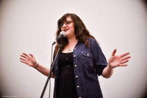 Jess Rizkallah performing at the 2016 Women of the World Poetry Slam in Brooklyn, New York. Photo by Valerie Jane Kwok.
