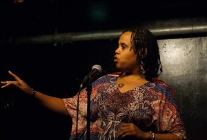 Vernell Bristow competes downstairs at the Cantab Lounge during the 2013 National Poetry Slam. Photo by Mark Skrzypczak.