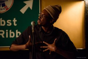 Evan Jymaal Cutts performs in the 2018 Boston Poetry Slam Team series. Photo by Marshall Goff.