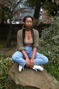 Denver poet, Yale grad, and Environmental Studies major Ashia Ajani. Photo by Alice Oh.