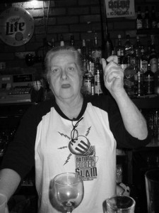 Judy Griffin behind the bar around 2007. (Judy's shirt is from the 1999 National Poetry Slam.) Photo by Caroline Harvey.