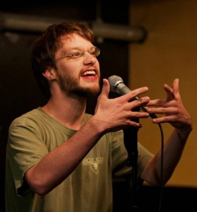 Nathan Comstock performs at the Wednesday open mic. Photo by Vasant Marur.