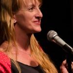 Jena Kirkpatrick spotlights on the open mic on October 15, 2014. Photo by Rich Beaubien.