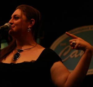 Emily Rose onstage upstairs at the Cantab at the National Poetry Slam.