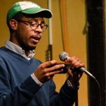 JR Mahung finishes out his hosting work with a cover poem. Photo by Rich Beaubien.