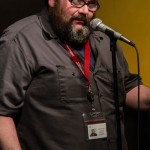Zeke Russell pauses to let the poem sink in. Photo by Rich Beaubien.