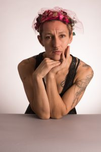 C Bain, gender-liminal performer and Publishing Triangle finalist. Photo by Kyle Hislip.