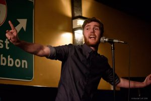 Host Kieran Collier performs in the Team Selection Slams. Photo by Marshall Goff.